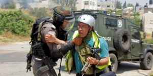 Bilal Tamimi being attacked by an Israeli soldier at a protest in Nabi Saleh in May 2013. © Tamimi Press