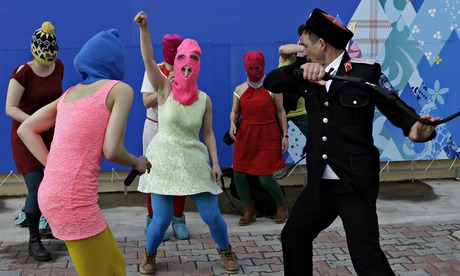 Members of the punk group Pussy Riot, including Nadezhda Tolokonnikova in the blue balaclava and Maria Alekhina in the pink balaclava, are attacked by Cossack militia in Sochi, Russia. Photograph: Morry Gash/AP (Via)